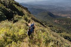Traveler trekking at Kew Mae Pan Nature Trail (Doi Inthanon National Park) .. Stock Photos