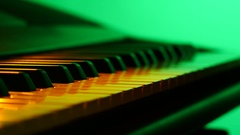 Playing on the Colored Piano Synthesizer Keyboard Stock Footage