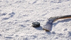Close-up on hockey puck and hockey equipment Stock Footage