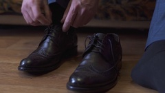 Groom is wearing shoes indoors. Male portrait of handsome guy. Beautiful model Stock Footage