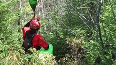 A man waking with his kayak near a waterfall on a river. Stock Footage