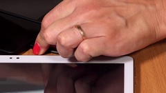 Hand connect micro usb cable to tablets and phones plugs Stock Footage