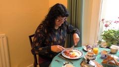 Woman having English breakfast Stock Footage