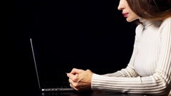 Beautiful brunette woman making online payment with her credit card using laptop Stock Footage