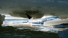 Ice Sheet Tunnel Dripping Scenic Rotation Slide Left HD Stock Footage