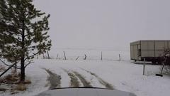 Rural Farm road snow storm drive truck POV HD Stock Footage