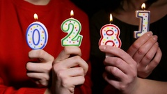 Hands holding burning candles with numbers New Year 2018 Stock Footage
