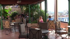 Tourists at the roof bar of the the Parque Central Hotel. Havana, Cuba. Stock Footage