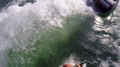 POV of a man wake surfing behind a boat on a lake, slow motion. Stock Footage