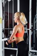 Young fitness woman demonstrate crossover exercises. The pectoral muscles, hard Stock Photos