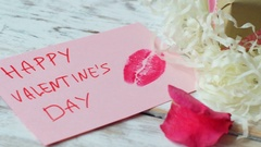 Valentine's day love card on rustic wood background, 4k dolly shot Stock Footage
