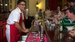 Bartenders are preparing cocktails (daiquiri & mojito)  in the Floridita bar. Stock Footage