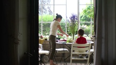Candid scene of mother serving food to her child Mother and kid Stock Footage