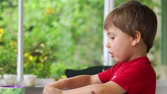 Close up of handsome boy eating lunch by himself 5 year old kid eating Stock Footage