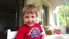 Portrait of handsome happy child grinning to camera joyfully. Stock Footage