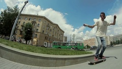 Guy makes a trick on a skateboard in the street Stock Footage