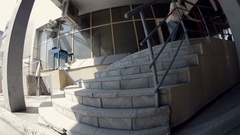 Guy does the trick with stairs on a skateboard Stock Footage