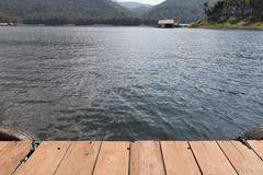 Wood Floor with Beautiful landscape of Lake in the mountains Stock Photos
