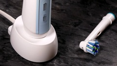 Electric toothbrush being placed on charger. Stock Footage