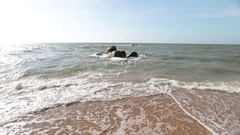Riverside, ocean waves lapping on the sand beach Stock Footage