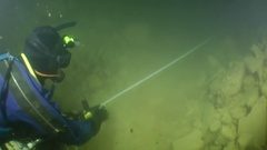 The diver-speleologist in the flooded mine. Stock Footage