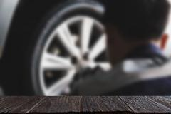 Auto mechanic in his workshop changing tires or rims (blur image) with sele.. Stock Photos