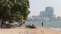 Pattaya Thailand November 26 Holidaymakers sunbathe and swim. Against the Stock Footage