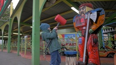 Slow motion view of small boy hitting with toy hammer game in amusement park Stock Footage