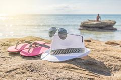 People take of cloth and relax on the beach Stock Photos