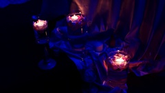 Element of the decor - burning candles in candleholders with rose petals Stock Footage