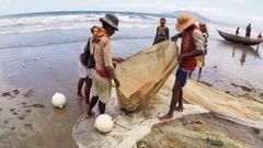 Native fishermen fishing on sea, using traditional technique pulling net Stock Footage