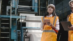 Male and Female Supervisors Inspecting Factory Stock Footage