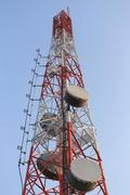 Antenna for Telephone communications in bright sky day time. Stock Photos