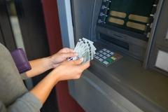 Close up of hand withdrawing money at atm machine Kuvituskuvat