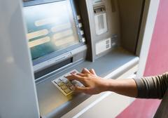 Close up of hand entering pin code at atm machine Stock Photos