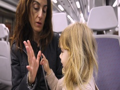Child counting mother fingers in a train Stock Footage
