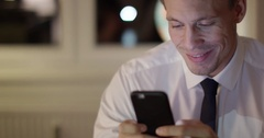 Businessman texting on phone Stock Footage
