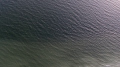 Aerial view footage of sea waves reaching shore. Top view on the beautiful sandy Stock Footage