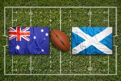 Australia vs. Scotland. flags on green rugby fieldAus Stock Illustration
