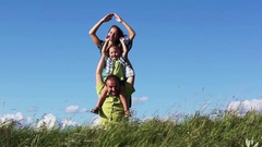 Happy family having fun outdoors in summer park Stock Footage