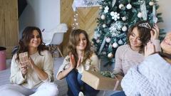 Smiling girlfriends talking near christmas tree. Xmas mood Stock Footage