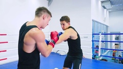 Man gets knocked down his opponent. Stock Footage