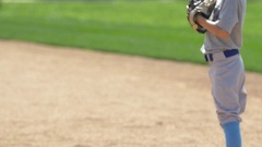 A boy catches and throws the baseball in the infield at little league baseball p Stock Footage