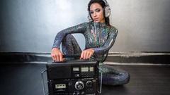 Ghettoblaster, hifi, radio, female sexy music disco club lifestyle catsuit Stock Footage