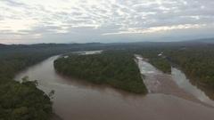 Rising high over the upper Rio Napo at dawn in the Ecuadorian Amazon Stock Footage