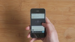 Vimeo video streaming app browsing from a smartphone, top view Stock Footage