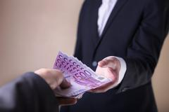 Bribe and corruption with euro banknotes. Stock Photos
