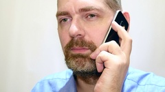 Bearded Man Talking At His Mobile Phone Arkistovideo