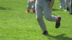 A boy catches the ball in the outfield at little league baseball practice. Stock Footage