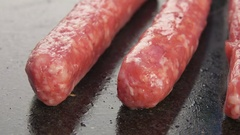 Delicious sausages fried on a grill Stock Footage